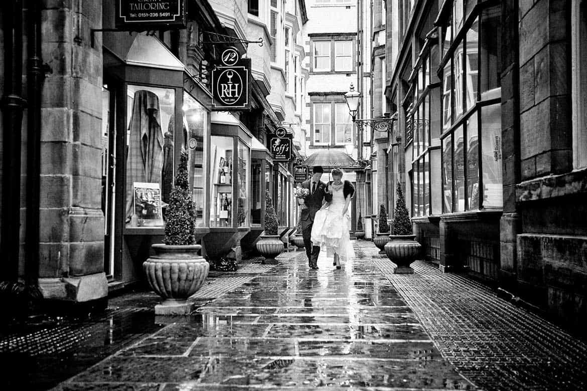 a walk in the rain for the bride and groom