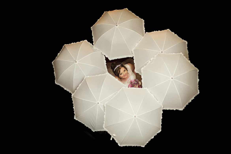 bride surrounded by umbrellas