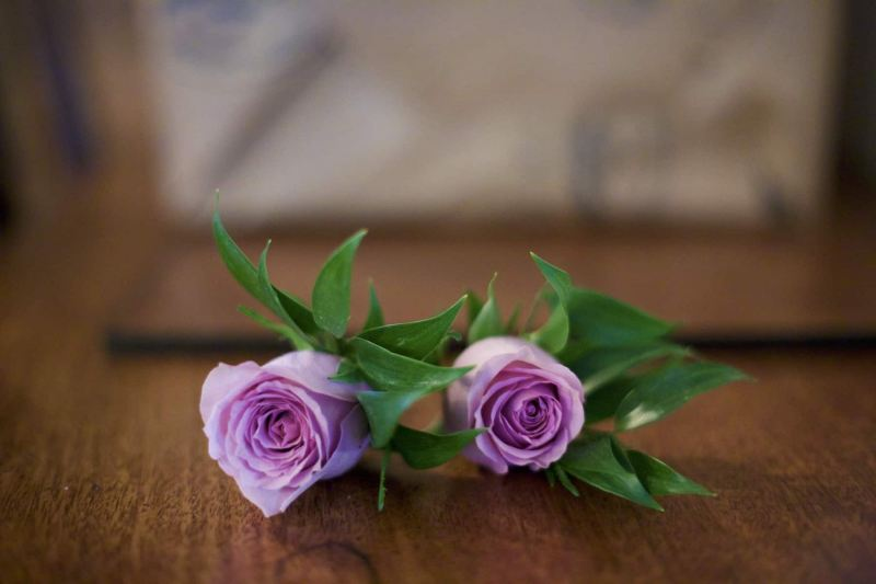 A pair of mens buttonhole flowers