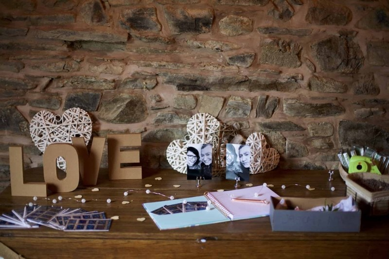 a collection of wedding trinkets on a table