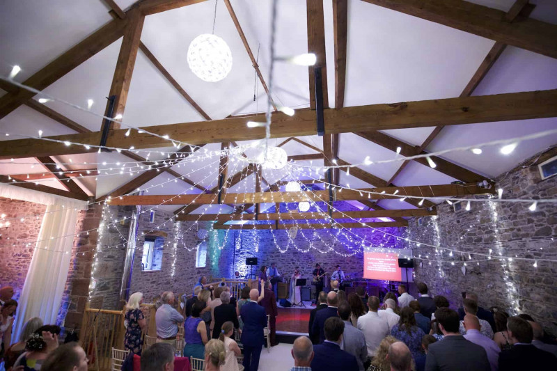 songs being sung in a barn wedding