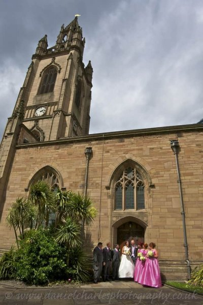bridal party outside church in bright sunshine liverpool wedding photograher