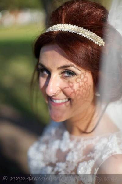 bride looking at camera with veil shadow on cheek