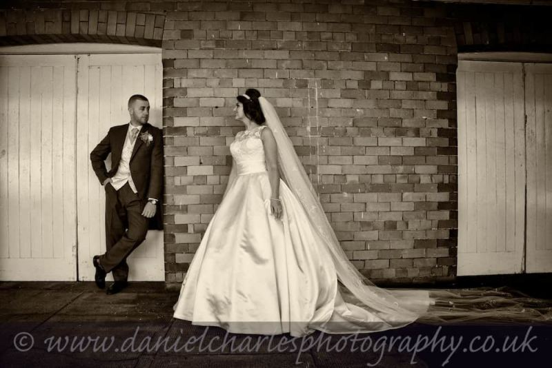 bride and groom standing by stable doors
