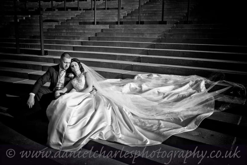 Bride and Groom seated on weighing room steps at Aintree Racecourse