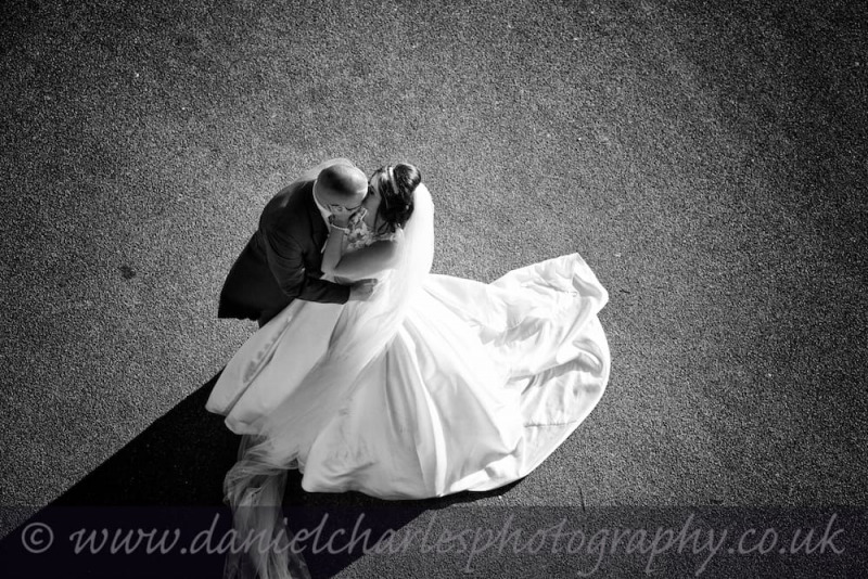 aerial view of bride and groom kissing black and white