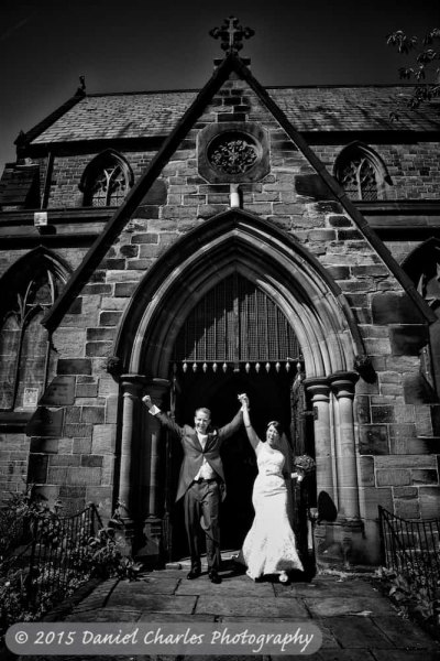 bride and groom celebrating as they leave st marys church liverpool