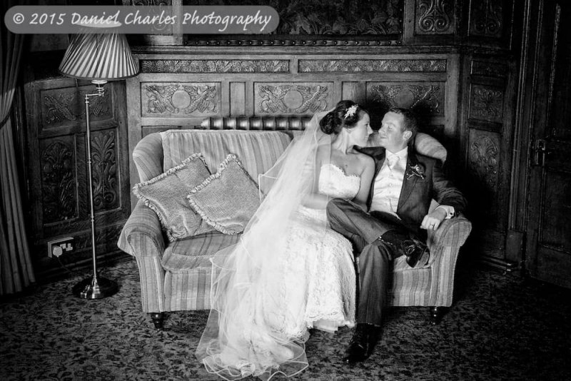 bride and groom seated on sofa black and white