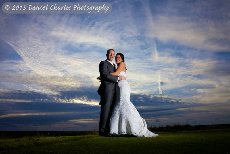 bride and groom embracing with big sky behind them