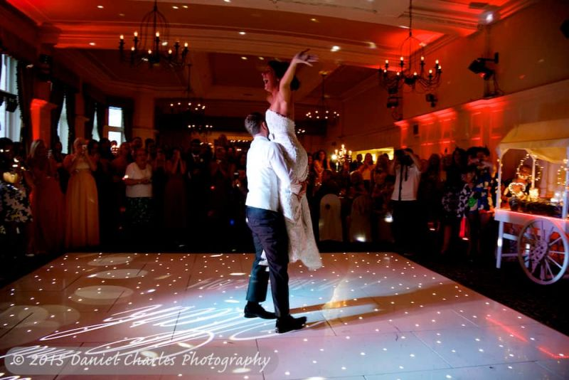 groom lifting bride into air during first dance