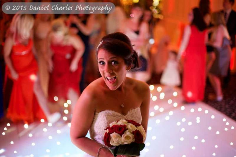 bride laughing as she prepares to throw bouquet