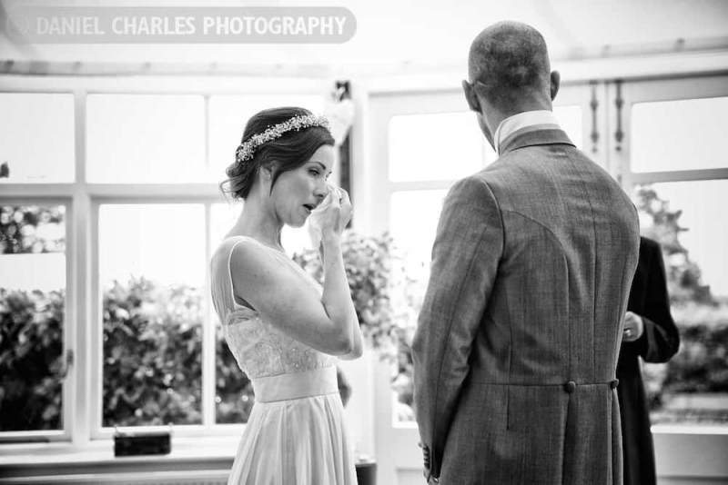 bride wipes away a tear. Black and white wedding photographer daniel charles photography