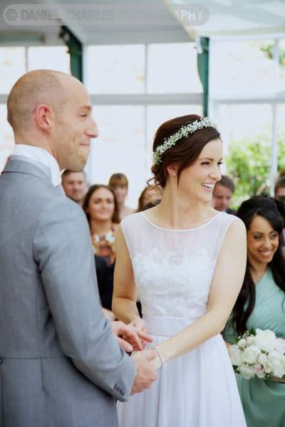 bride and groom laughing in combermere abbey wedding