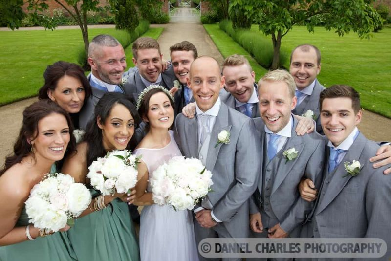 bridal party at combermere abbey gardens