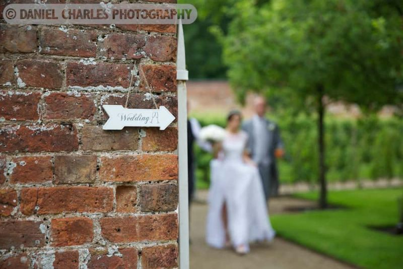 an arrow shows where the wedding is as the couple approach