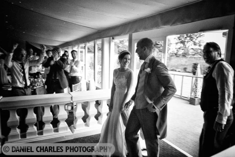 the bride and groom enter the reception marquee, combermere abbey