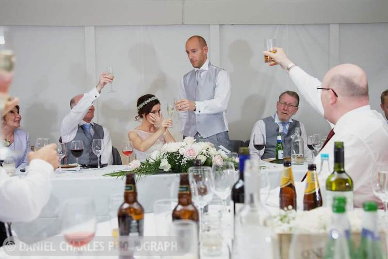 bride crying as groom toasts her in speeches