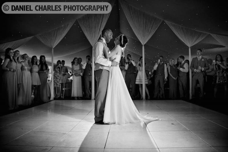 black and white wedding photograph of first dance of bride and groom