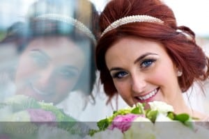 portrait of bride reflected in glass