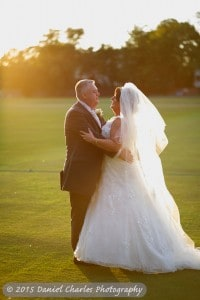 bride and groom embracing in sunset light at Liverpool Cricket Club