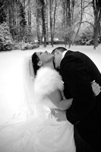 black and white photo of groom kissing brides neck clearwell castle wedding