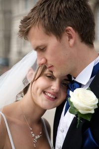 bride leaning on grooms chest by st georges hall