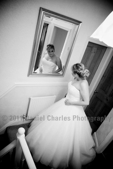Bride glancing at her reflection in mirror