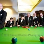 The men relaxing at a wedding with a game of snooker