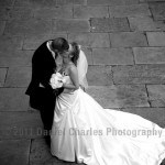couple kissing black and white