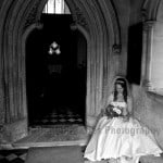 Bride seated in porch of church