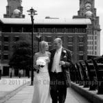 the couple walking in Liverpool after the wedding