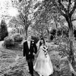 bride and groom walking in the evening