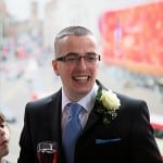 groom laughing with drink in hand at St Georges hall