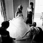 bridesmaids adjusting the bride's dress at leasowe castle