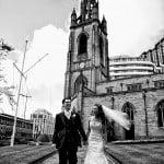 bride and groom walking, laughing through garden