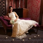 bride reclining on chaise longue with candles