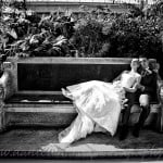 bride and groom reclining on stone seat