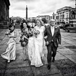 bride, father and bridesmaids approach st george's hall