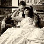 bride and groom reclining on sofa
