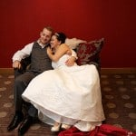 bride and groom reclining on armchair