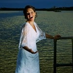 Bride laughing on jetty