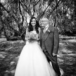 Bride and father share a joke