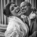 Bride and groom laughing in embrace