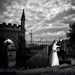 bride and groom leaning over fence in st nicholas gardens
