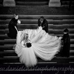 bridesmaids adjusting wedding dress