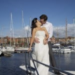bride and groom on deck of cruiser